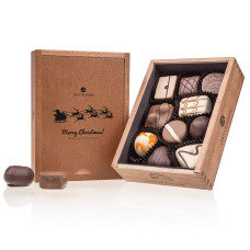 wooden chocolate box with pralines, Christmas chocolate pralines