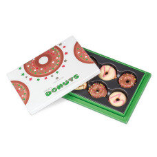 Four delicious, round chocolate donuts with strawberry