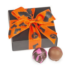 Halloween package covers 4 delicious, orange chocolate pumpkins.